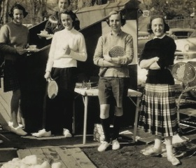 Pamela McCrae (second from right) at a Fox Meadow women's tea in the 1950s. Buffy Briggs is on the left. The two others in the front are Elise Clairborne and Evie Carlisle (far right)