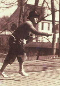 Caption: James K. Cogswell on the first platform paddle tennis court erected on his property