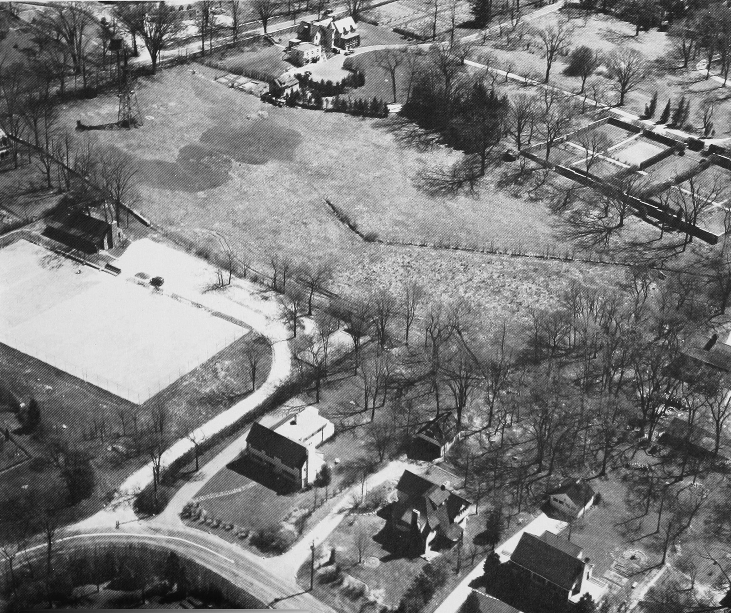 Aerial view of FMTC in 1937. At the left stands the windmill in Crane Meadow, just below Church Lane. The first paddle court can be seen at the curve of the driveway.