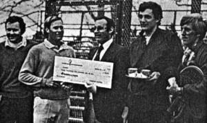 Passport Scotch's Jeff Gollin presents winning check to Steve Baird (left) and Rich Maier. Runners-up were Herb Fitz Gibbon and Hank Irvine