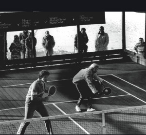 During one of the Tribuno Tour events, Hank Irvine hits a service volley while Herb Fitz Gibbon closes in on the center. This team dominated several of the Tribuno tournaments and won the Nationals in both 1977 and 1978
